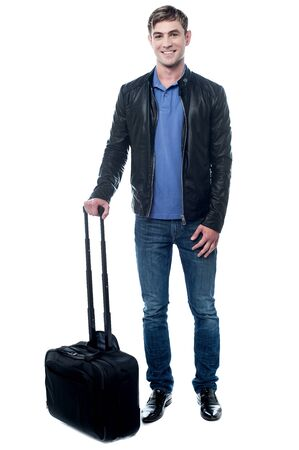 cool guy: Confident cool guy posing with trolley bag