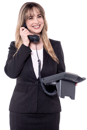 woman at the phone: Smiling middle aged business woman on phone