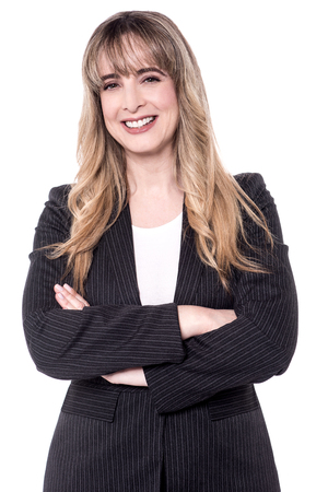 aged business: Middle aged business woman posing with arms crossed