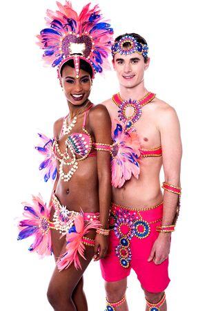 carnival costume: Happy samba dancers posing together in carnival costume