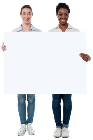 space   area: Women holding a whiteboard, copy space area.