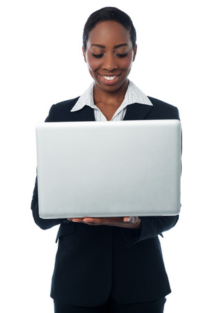 Corporate woman working on laptop