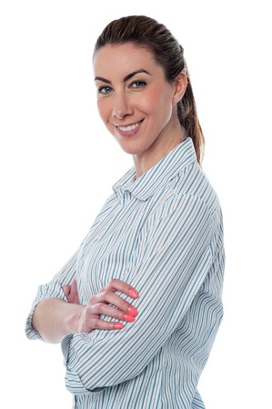 Side pose of a business lady, crossed arms. photo