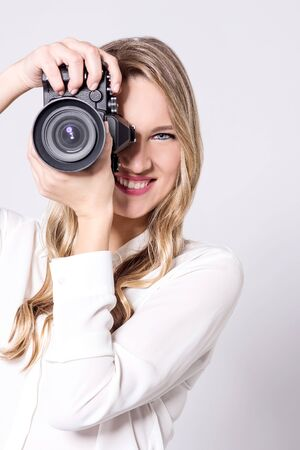smile please: Female photographer with professional camera