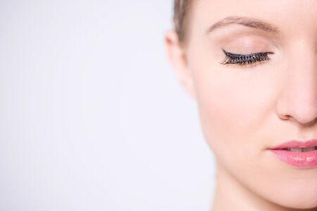 space   area: Makeup woman, face closeup. Copy space area.