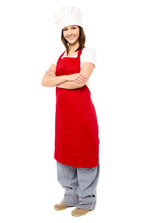 folded arms: Confident female chef posing with folded arms