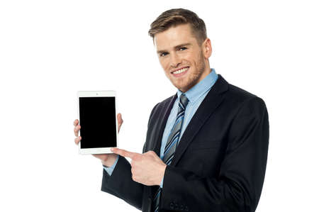 pointing device: Young entrepreneur pointing at new smart device