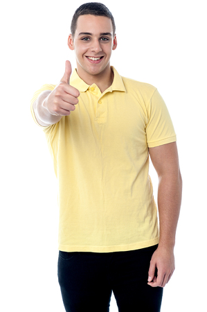 Boy showing thumbs up sign to the camera