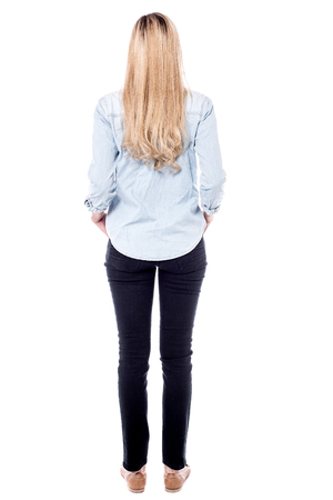facing away: Tall woman facing away, white background.