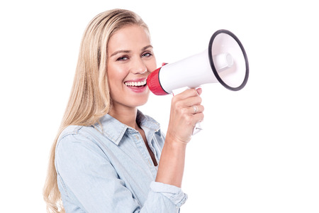 making an announcement: Joyous lady making an announcement Stock Photo