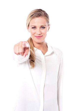 half length: Lady pointing towards camera, half length shot.