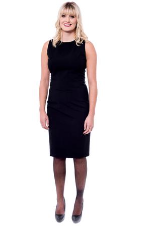 sleeveless dress: Pretty classy female model in black sleeveless dress Stock Photo