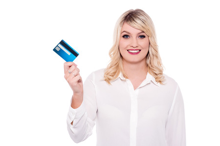 delightful woman holding atm card stock photo picture and royalty