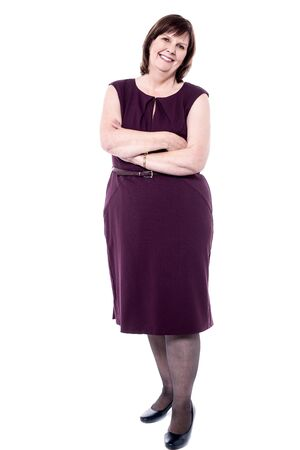 calm woman: Senior woman in party wear with crossed arms Stock Photo