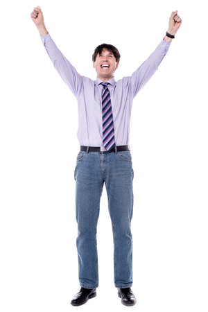 clenching fists: Successful business man raised his arms with clenching fists.
