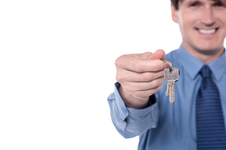 executive apartment: Cropped image of businessman offering house keys.