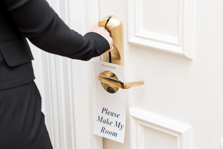 room door: Lady unlocking the door for room service