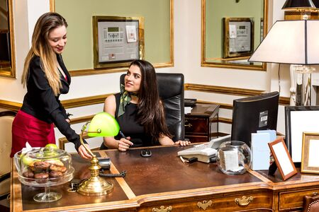 front desk: Two beautiful receptionists at front desk
