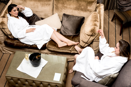 bath gown: Pretty young women relaxing after spa