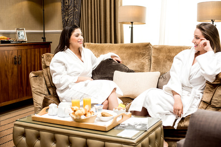bath gown: Lovely ladies gossiping in bathrobe Stock Photo