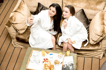 bath gown: Young women taking selfie in bathrobes