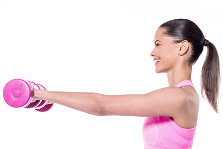 free weights: Pretty happy young woman exercising with free weights Stock Photo