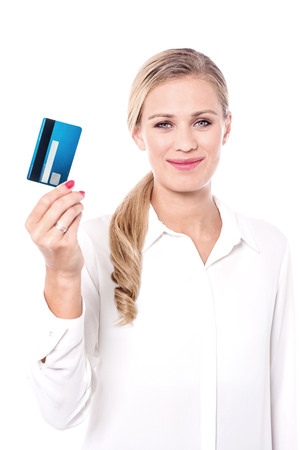 attractive charismatic: Corporate executive showing her credit card to camera.