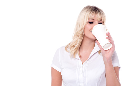 attractive charismatic: Attractive young lady drinking coffee at break. Stock Photo