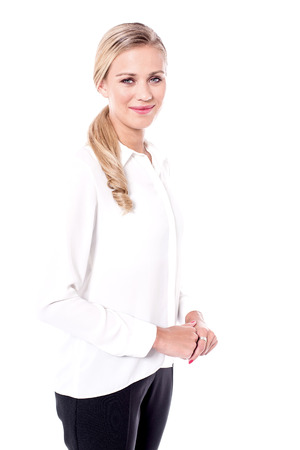 clasped hands: Business woman with clasped hands looking at camera