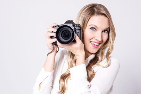 smile please: Say cheese, I am all set to click. Stock Photo