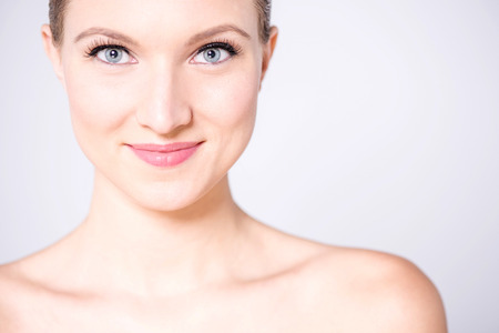 make over: Young woman with calm smile on her face posing to camera