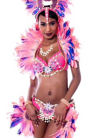 rehearse: Carnival dancer poses in front of the studio background Stock Photo