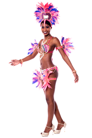 stage costume: Beautiful young samba dancer in pink stage costume.