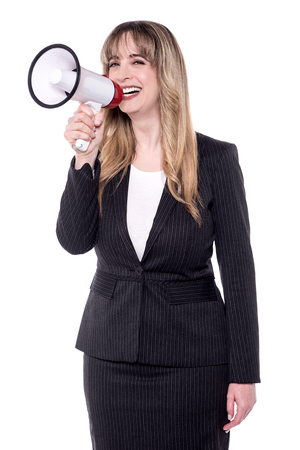 making an announcement: Businesswoman making announcement with megaphone over white.