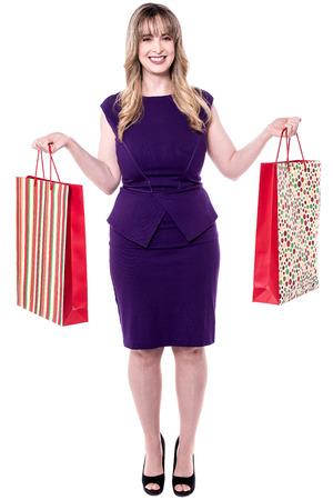 shopaholic: Shopaholic woman isolated over white Stock Photo