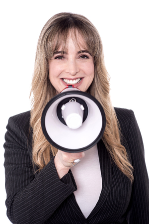 loudhailer: Corporate woman making announcement with loudhailer Stock Photo