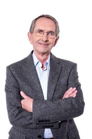 casual wear: Aged man posing with his arms crossed. Stock Photo
