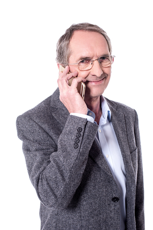 half dressed: Senior man talking on mobile phone over white. Stock Photo