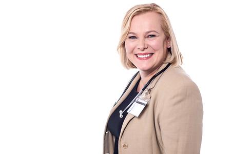 surgical coat: Smiling senior female doctor posing to camera.