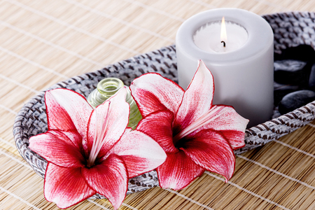 Image of burning candle and lily.