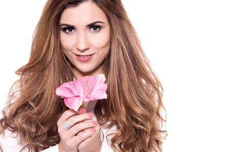 stargazer lily: Attractive young woman holding lily flower.