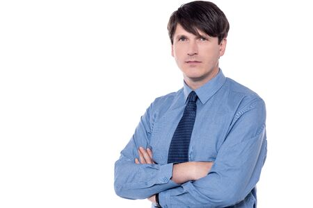 folded arms: Serious male executive posing with folded arms. Stock Photo