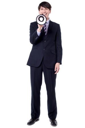 Full length image of businessman making announcement.