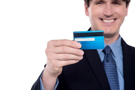 Blurred image of businessman holding credit card.