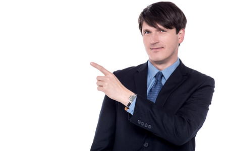 Business professional pointing away Stock Photo