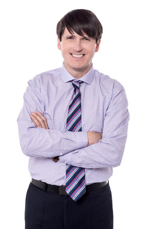 Businessman folding his arms shot on an isolated background. Stock Photo