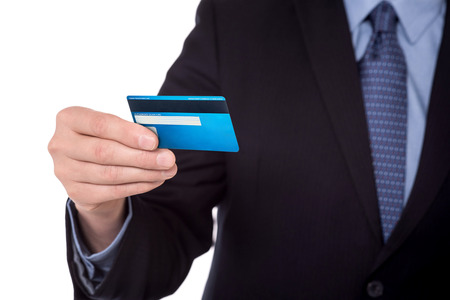 Cropped image of businessman showing credit card.