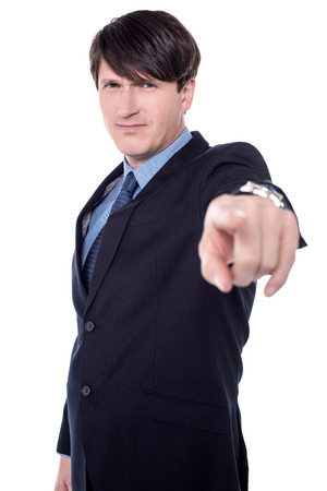 Businessman pointing at camera isolated on a white background.