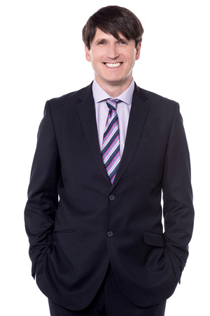 Happy boss posing to camera with hands in pockets. Stock Photo