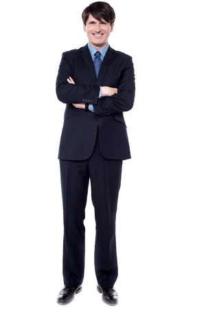 Confident middle aged businessman posing on white background.